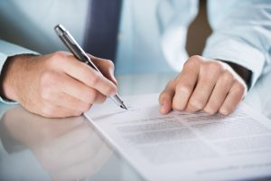 Business Law Solicitors writing a contract